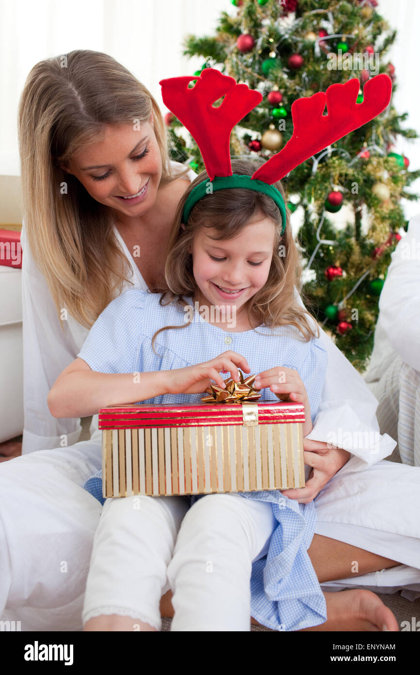 Portrait Of A Mother And Her Daughter Unpacking Christmas