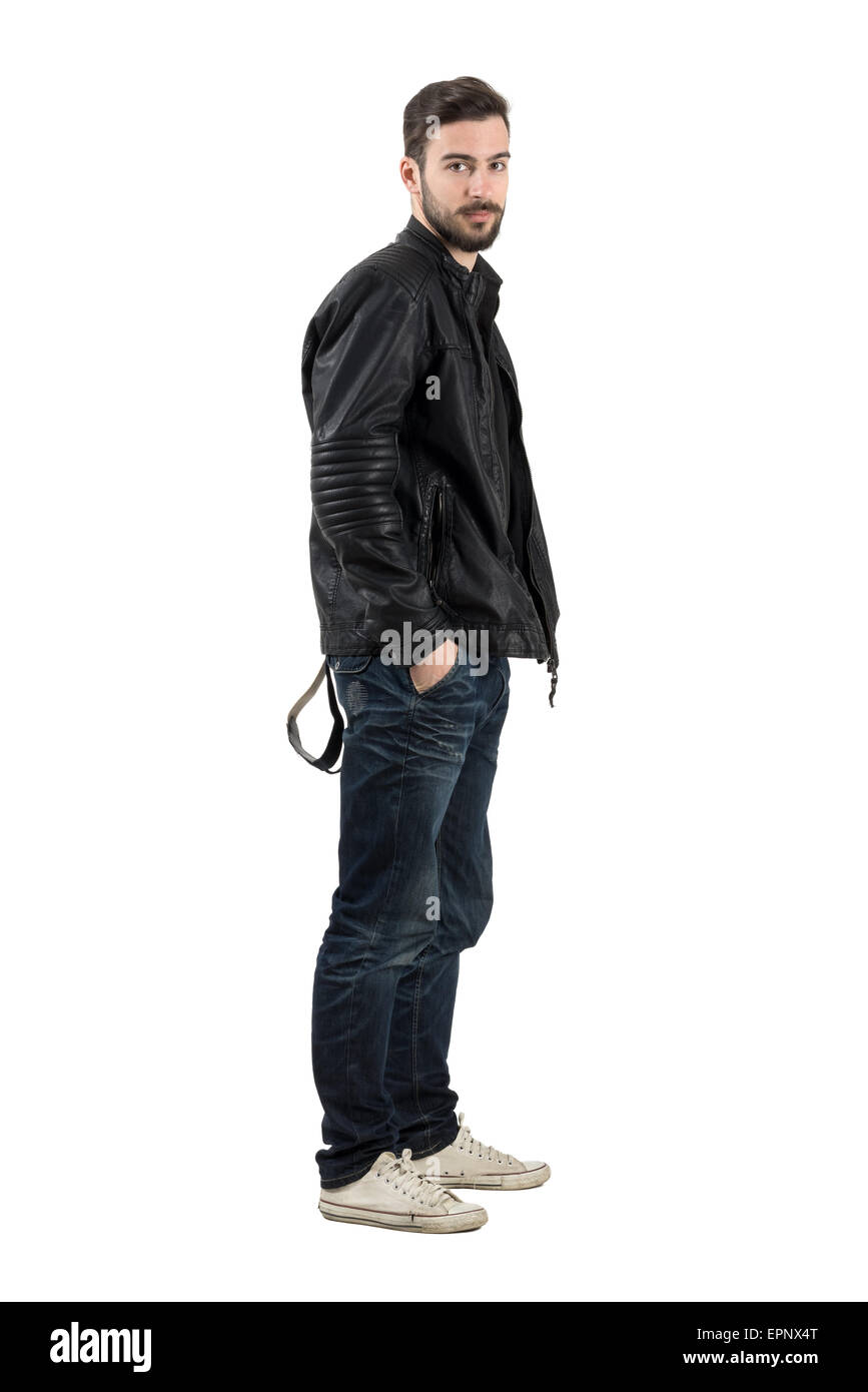 Side view of young fashion model in black leather jacket ...
