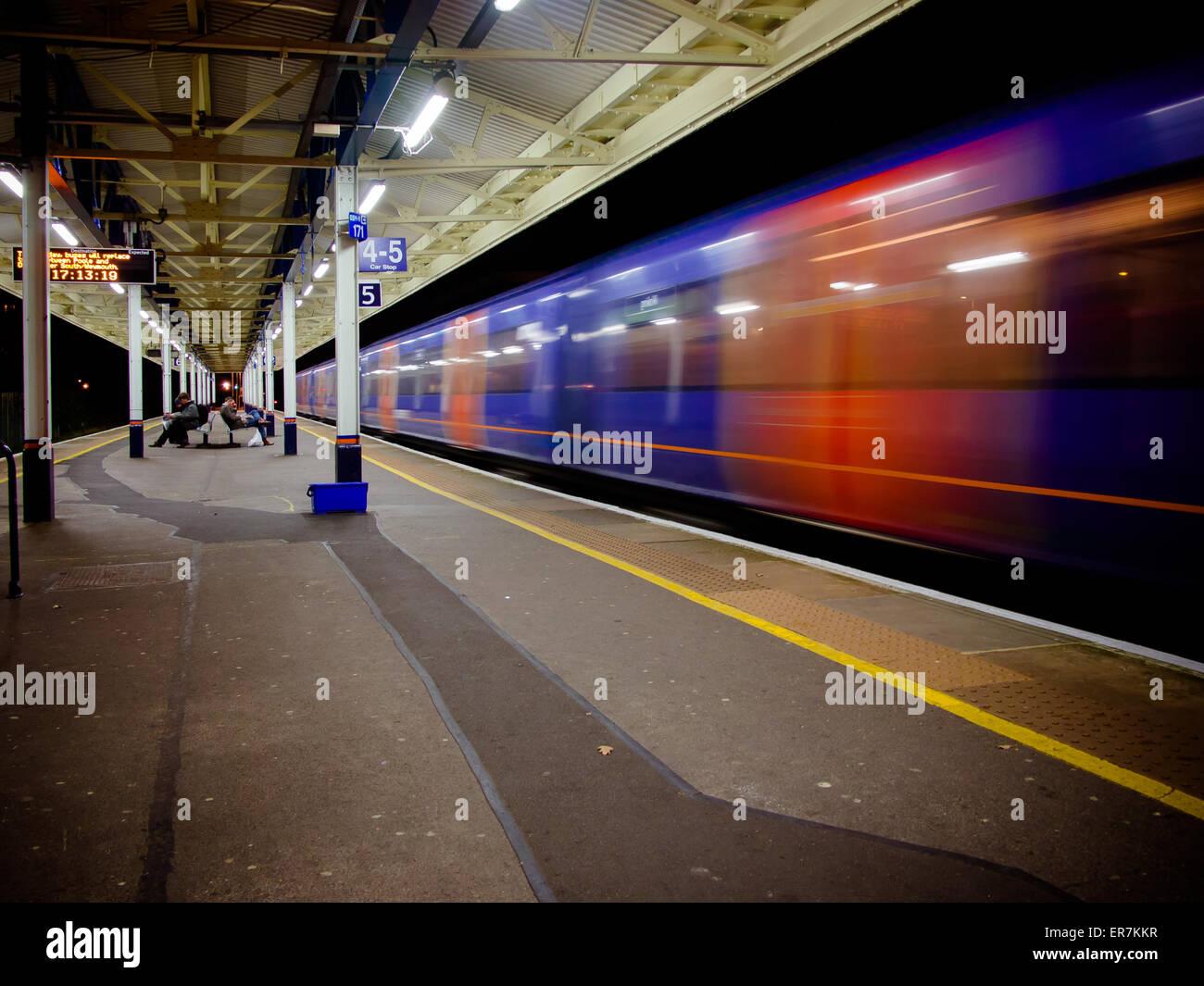 a-train-speeding-through-a-train-station