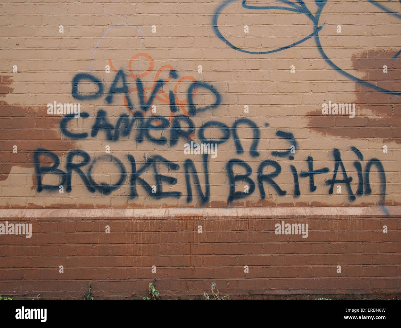 political-graffiti-spray-painted-on-a-wall-proclaiming-david-camerons-ERBN8W.jpg