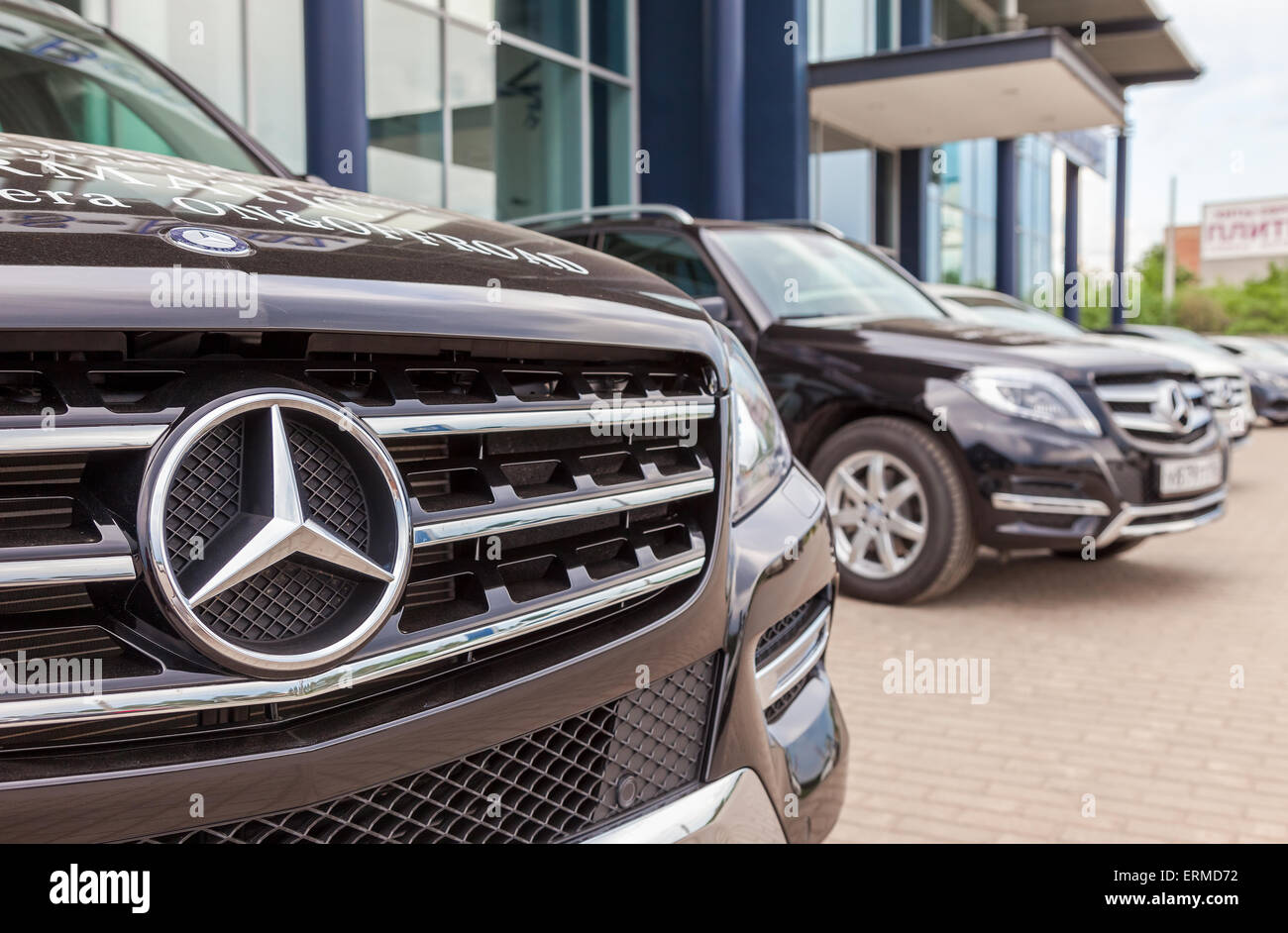 Grille of a mercedes benz car with the famous star stock for Star motor cars mercedes