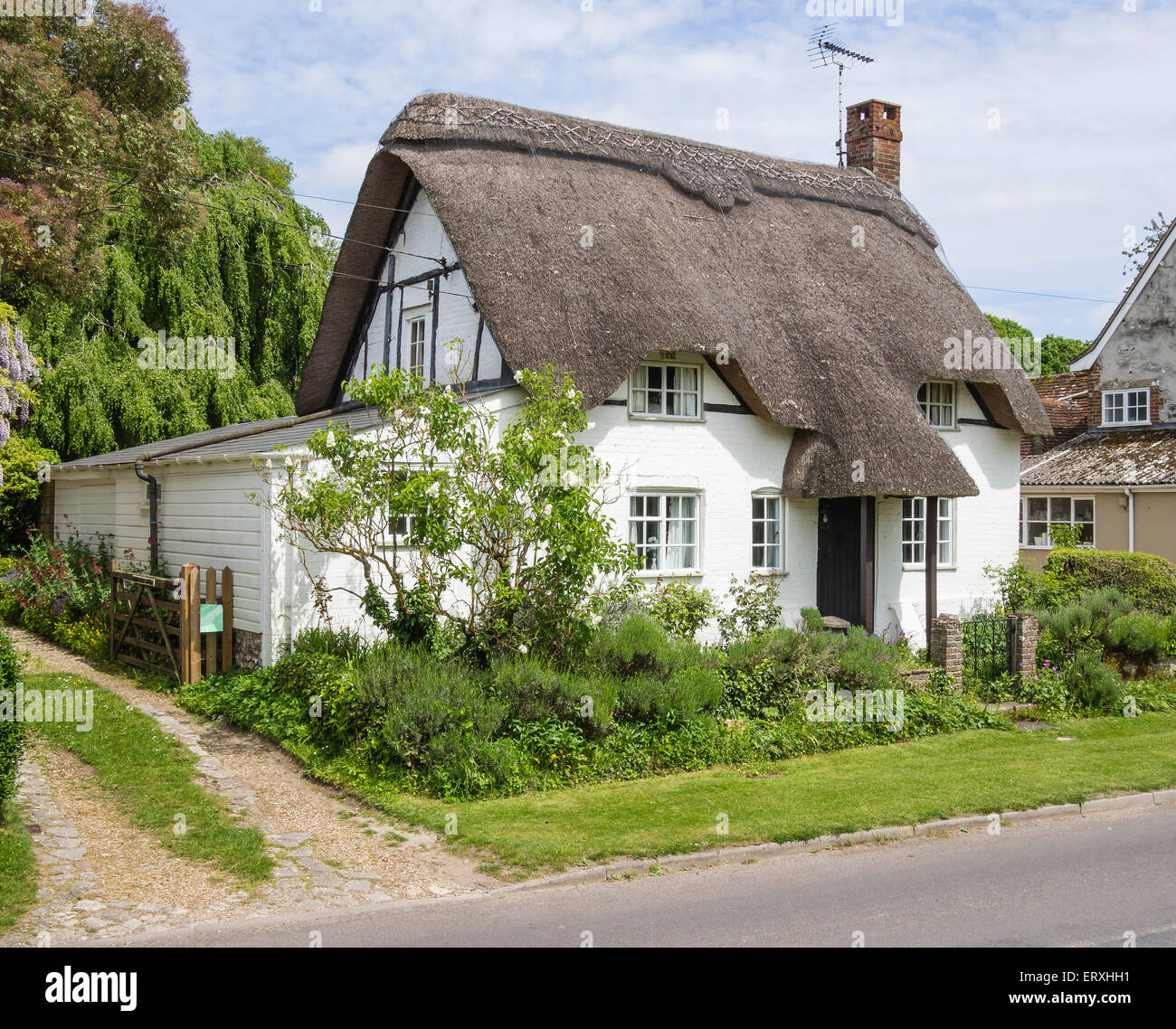 Thatched cottage in the village of martin hampshire uk stock photo royalty free image - The thatched cottage ...