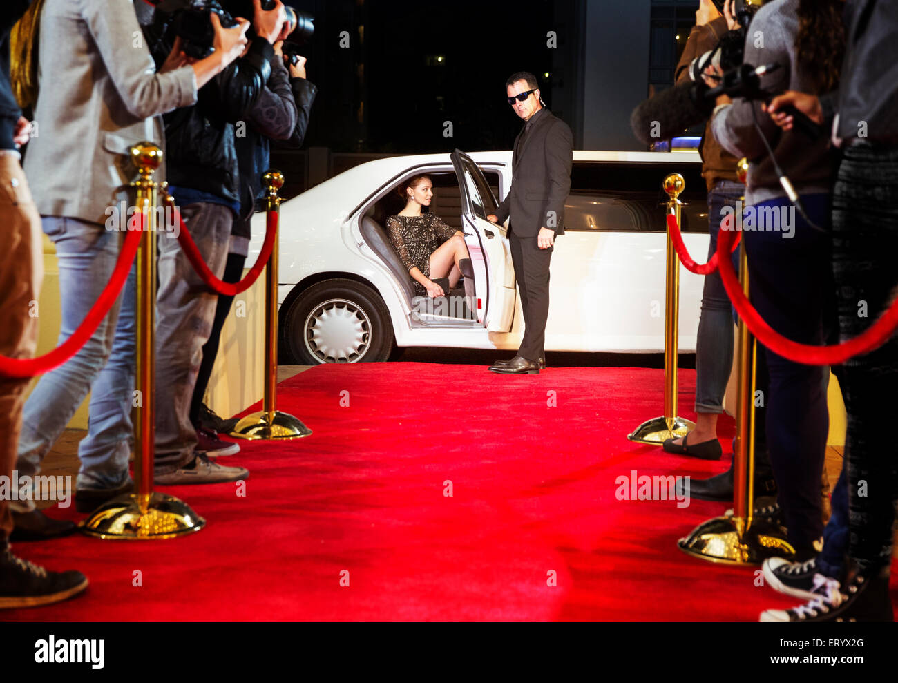 Bodyguard Opening Limousine For Celebrity Arriving At Red Carpet Stock