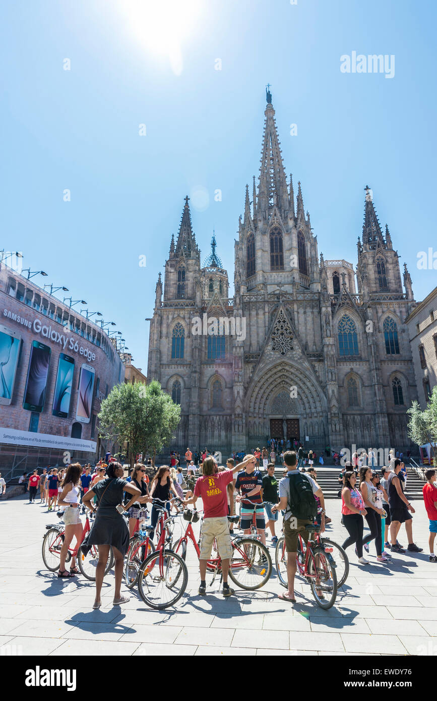Stock Photo - Cycling tour group with a guide in front of the Barcelona cathedral in Catalonia, Spain