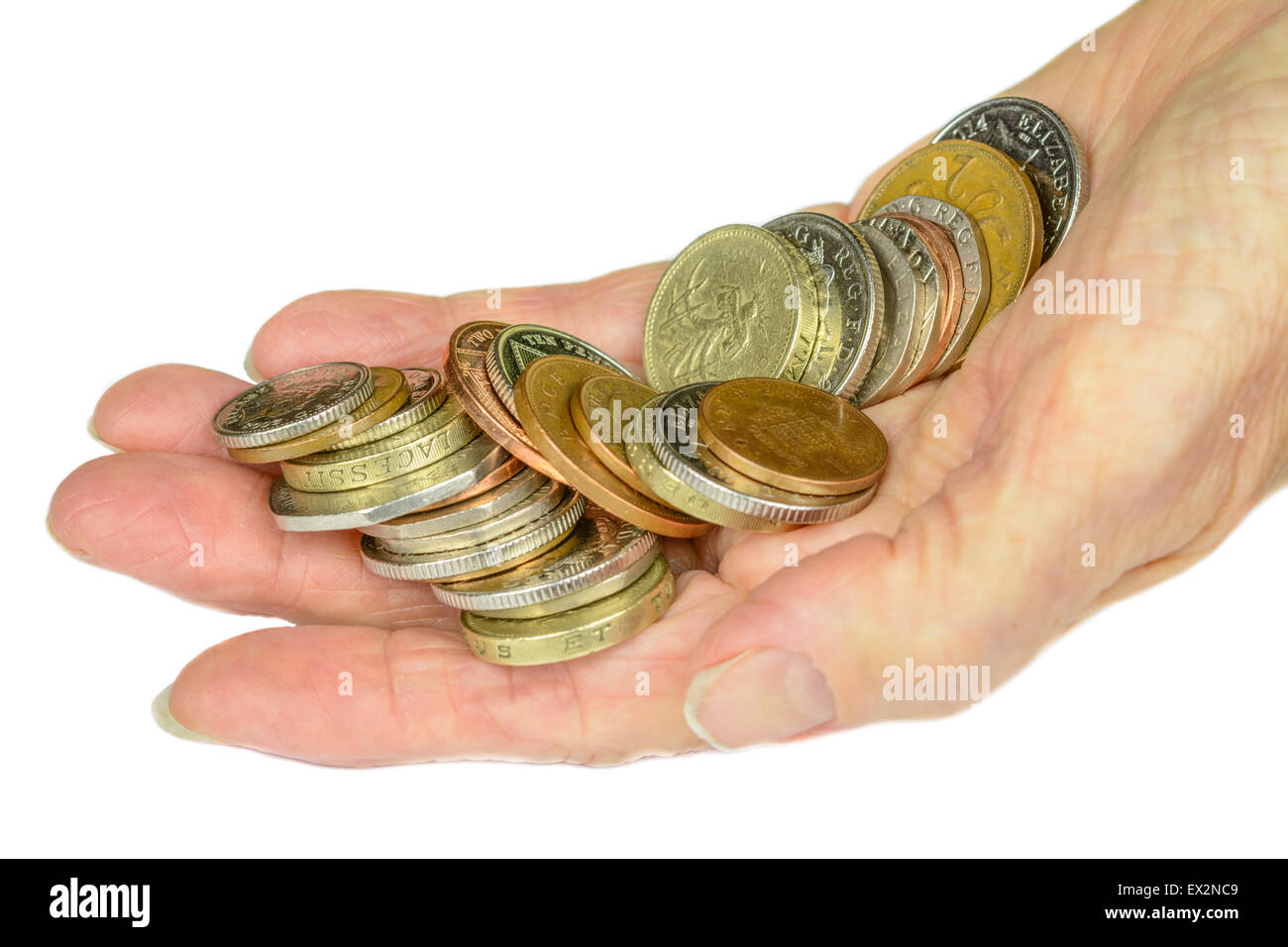 Woman's hand holding UK decimal sterling coins on a white background. Stock Photo