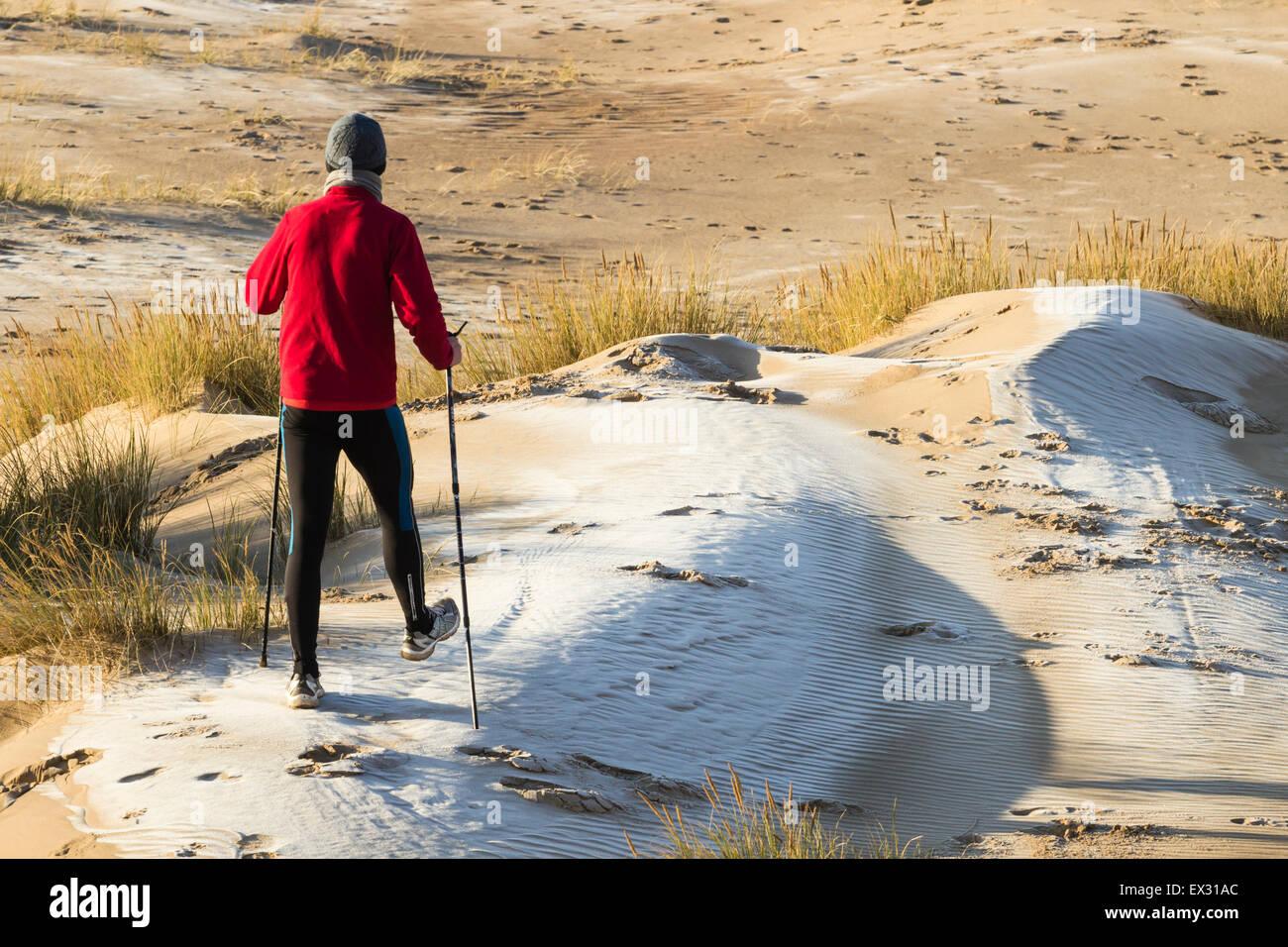 a-walker-on-seaton-carew-beach-at-sunris