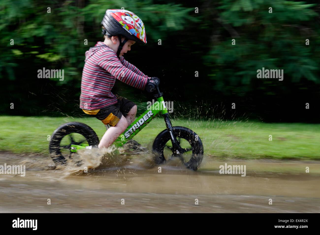 a-young-boy-3-yrs-riding-a-balance-bike-