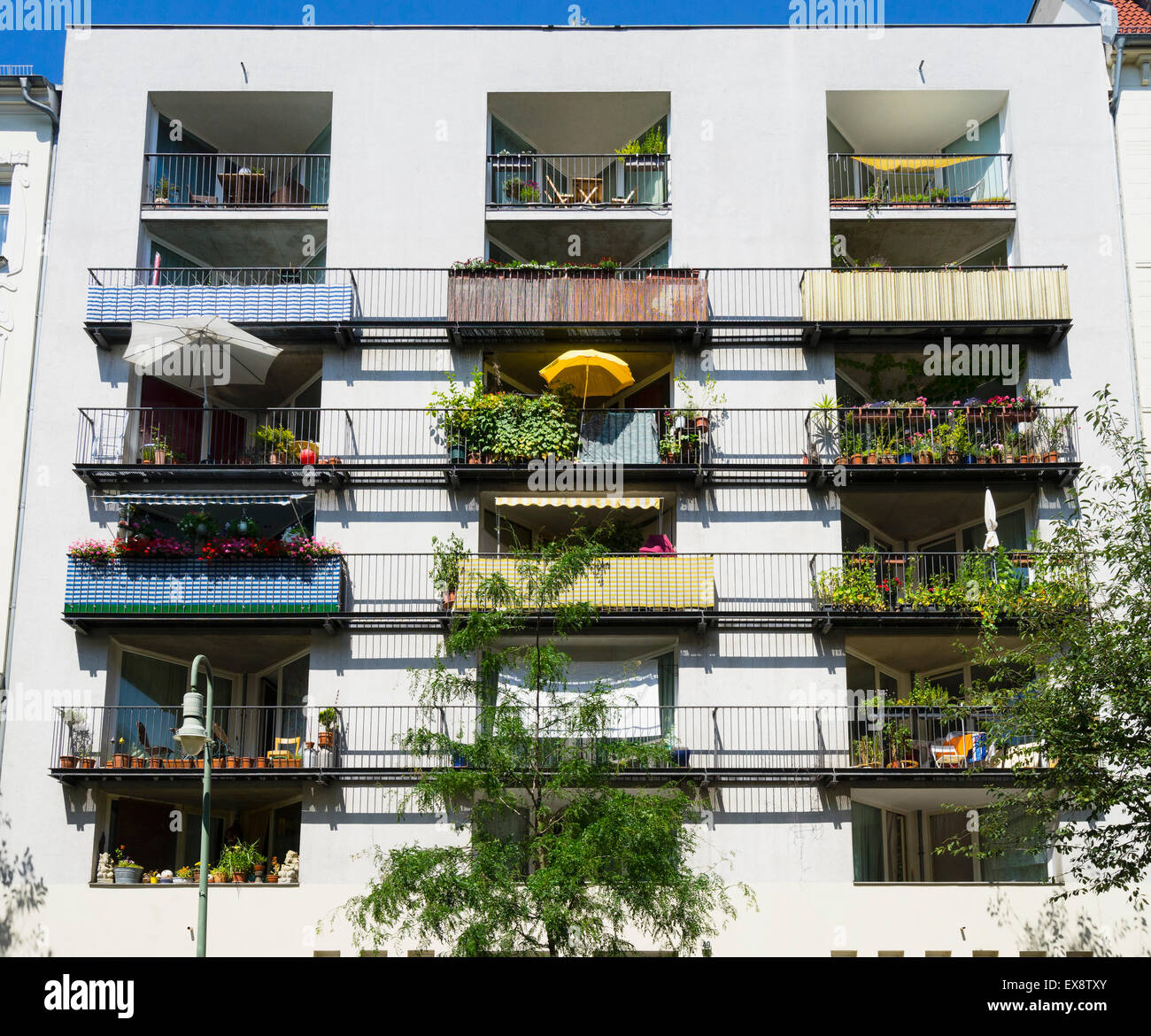 Balconies in summer in modern apartment building in ...