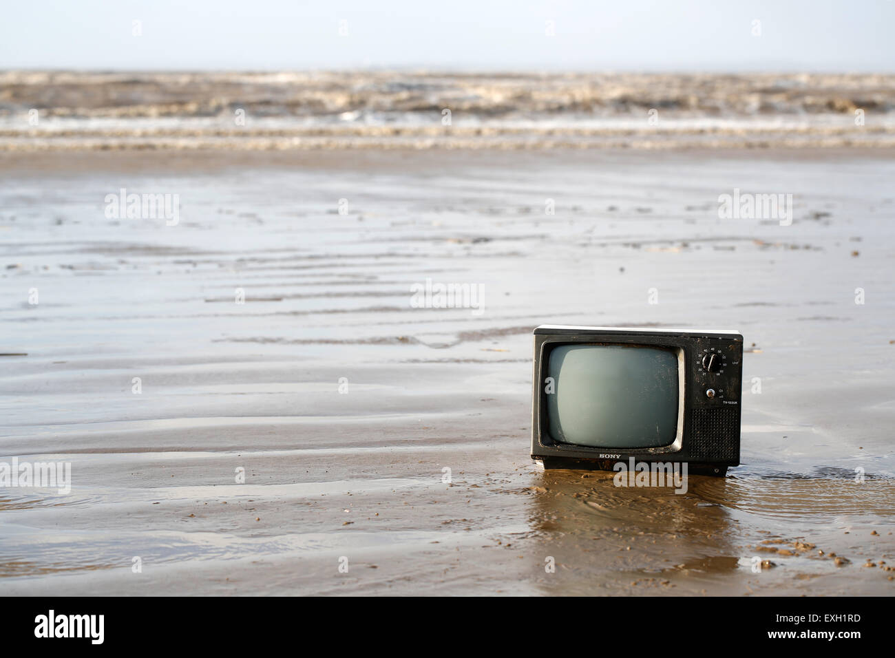 an-discarded-tv-washed-up-onto-a-beach-w
