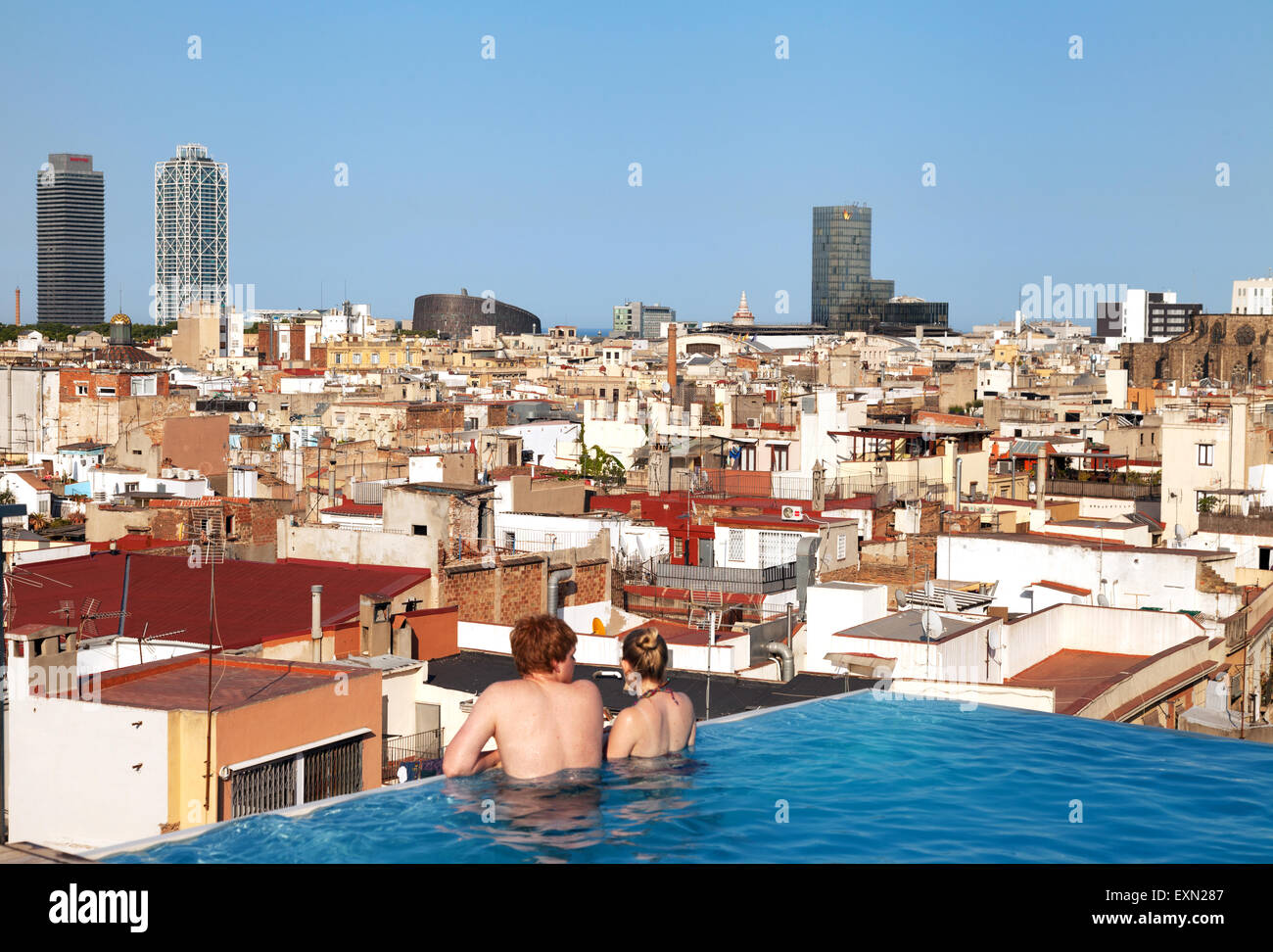 tourist couple in the infinity pool on the roof grand hotel central stock photo royalty free. Black Bedroom Furniture Sets. Home Design Ideas