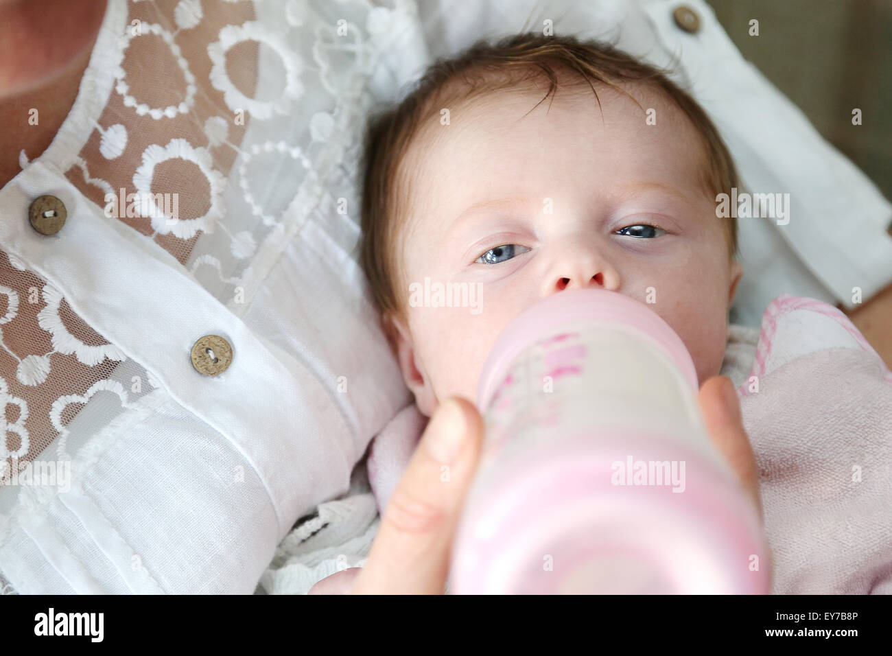 a-very-young-baby-being-fed-milk-from-a-