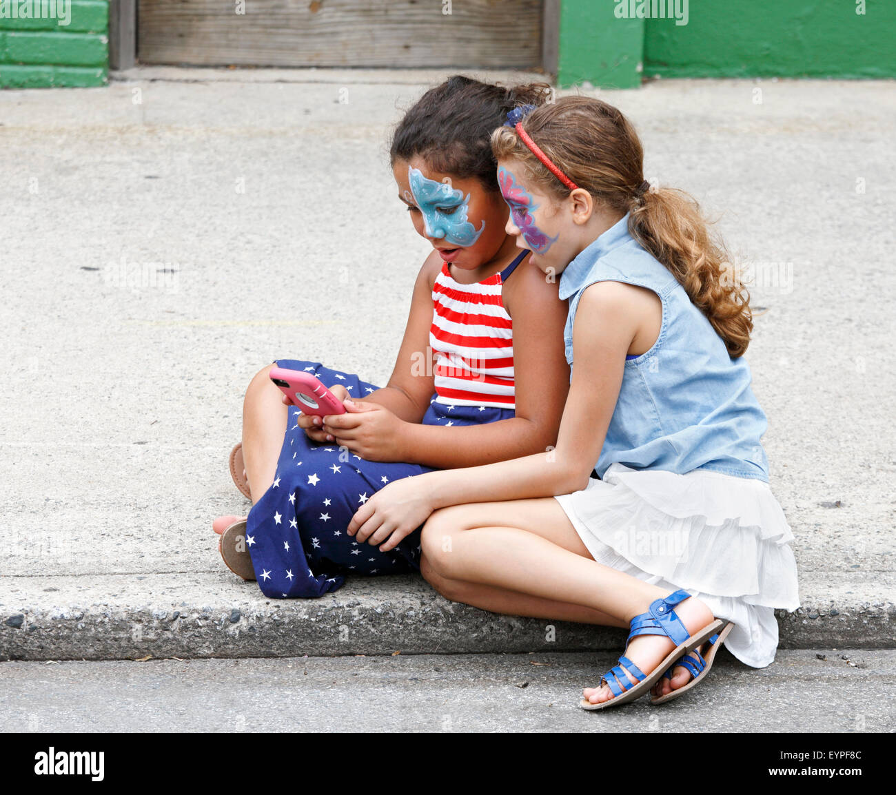 two-young-girls-watching-using-a-smart-p