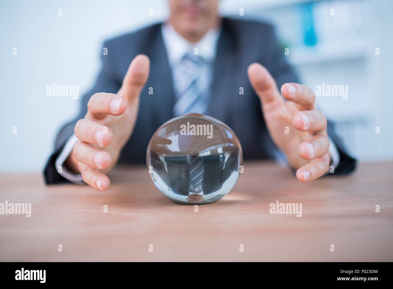 Businessman forecasting a crystal ball Stock Photo
