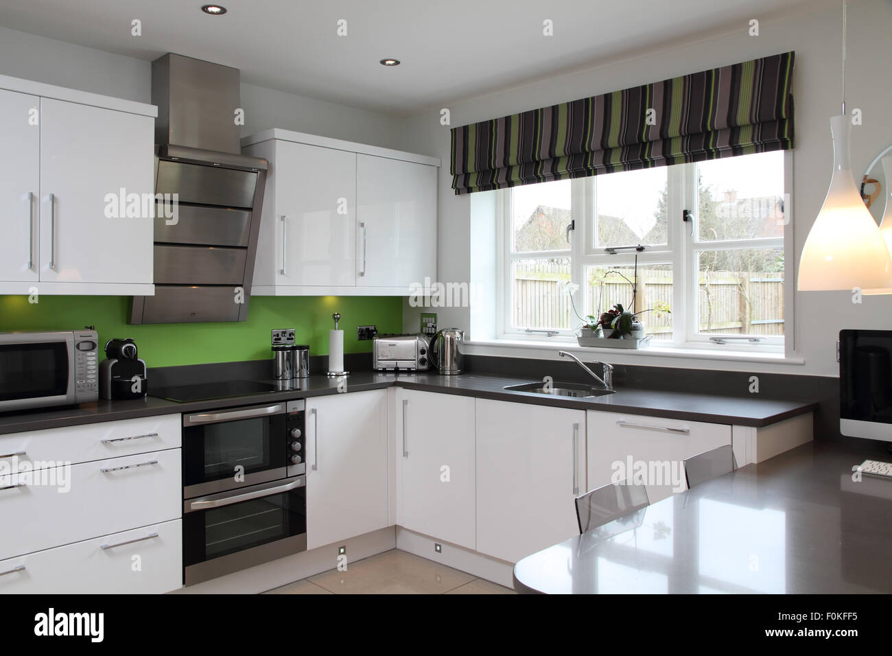 Black And White Modern Kitchen With Lime Green Splash Back