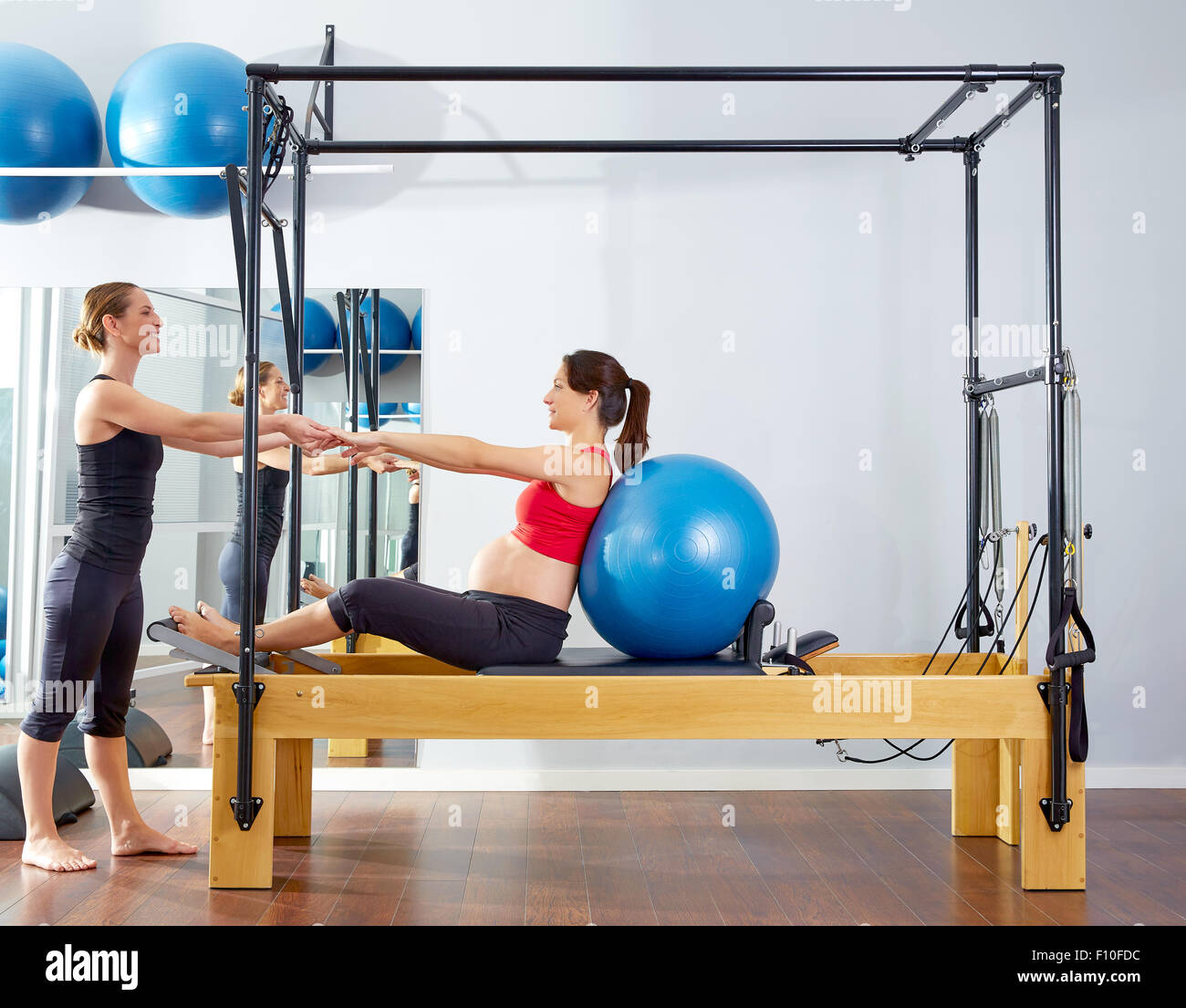 Woman Pilates Chair Exercises Fitness Stock Photo: Pregnant Woman Pilates Reformer Cadillac Fitball Exercise