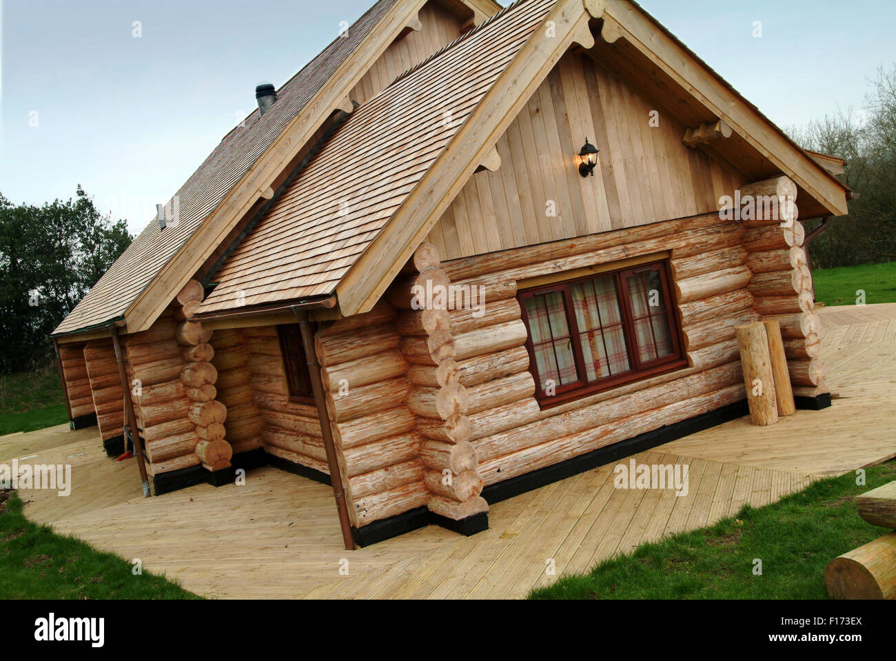A large modern wooden log house in somerset uk stock photo for Modern log house