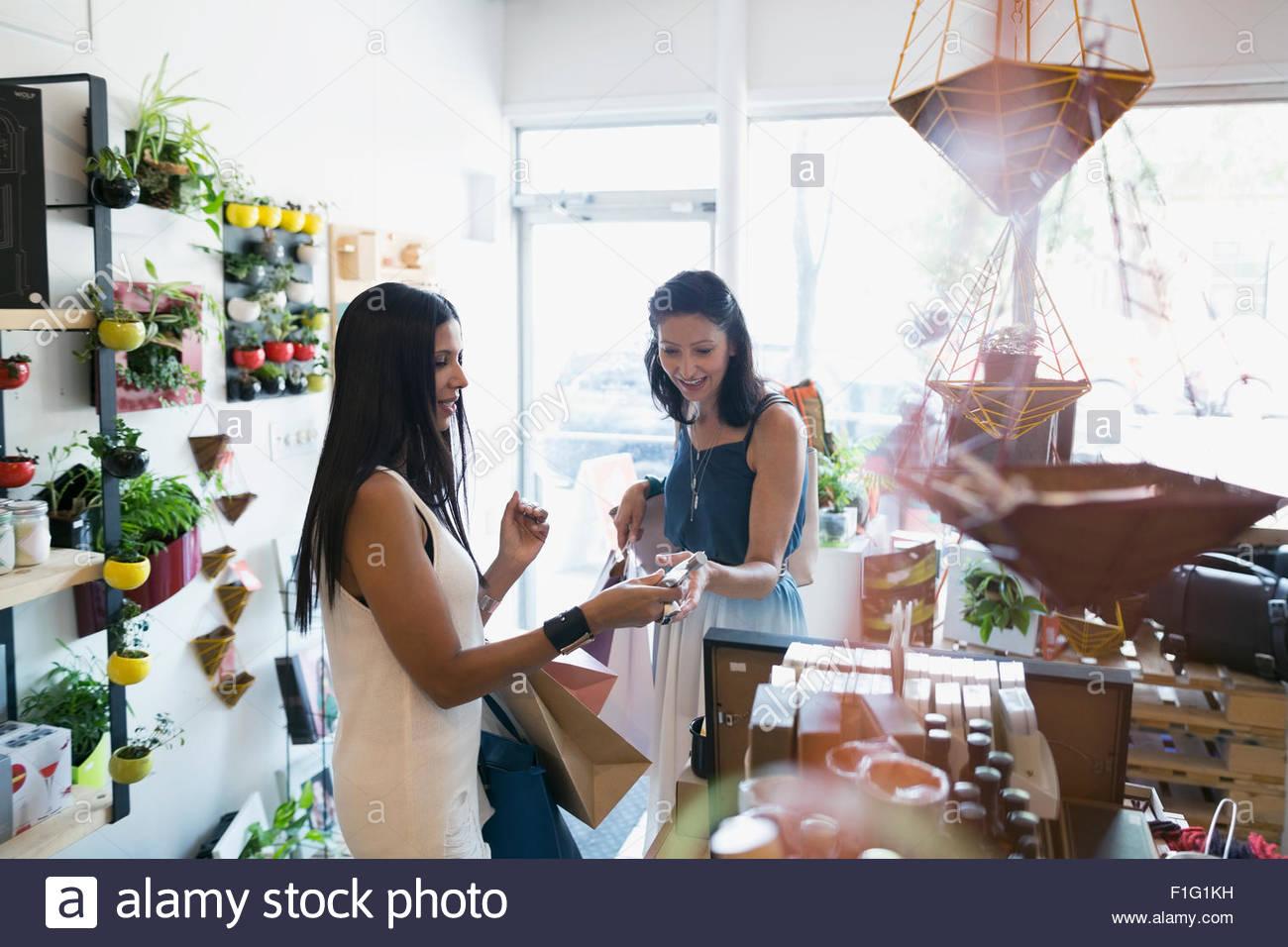 Women shopping in housewares shop Stock Foto