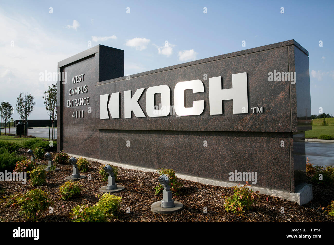 A logo sign outside of the headquarters of koch industries for Koch industrie