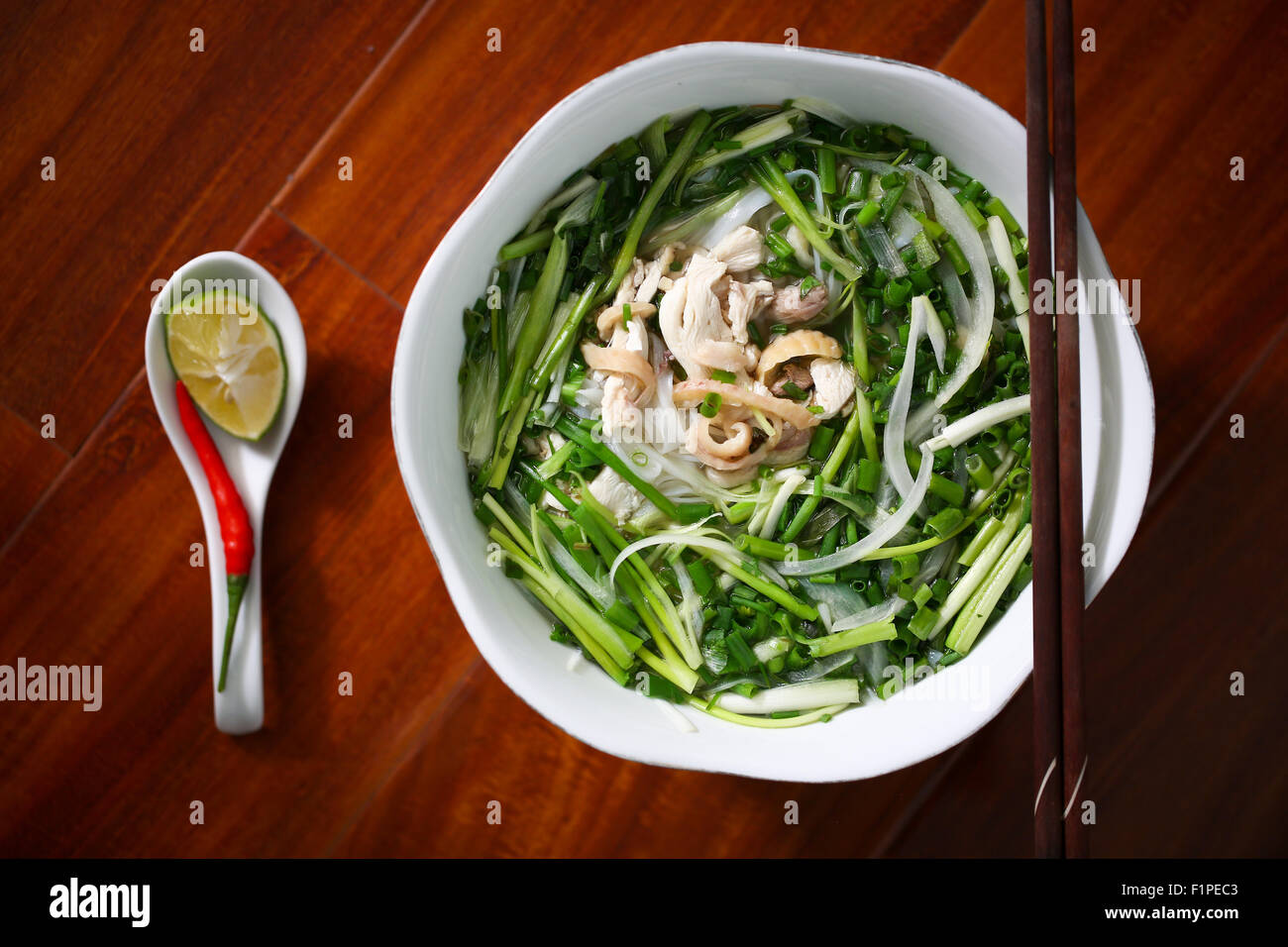 Stock Photo - Pho, a traditional Vietnamese gourmet food, in a closeup view