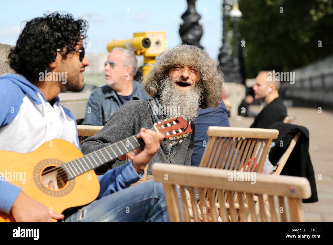 a-man-playing-an-acoustic-guitar-enterta