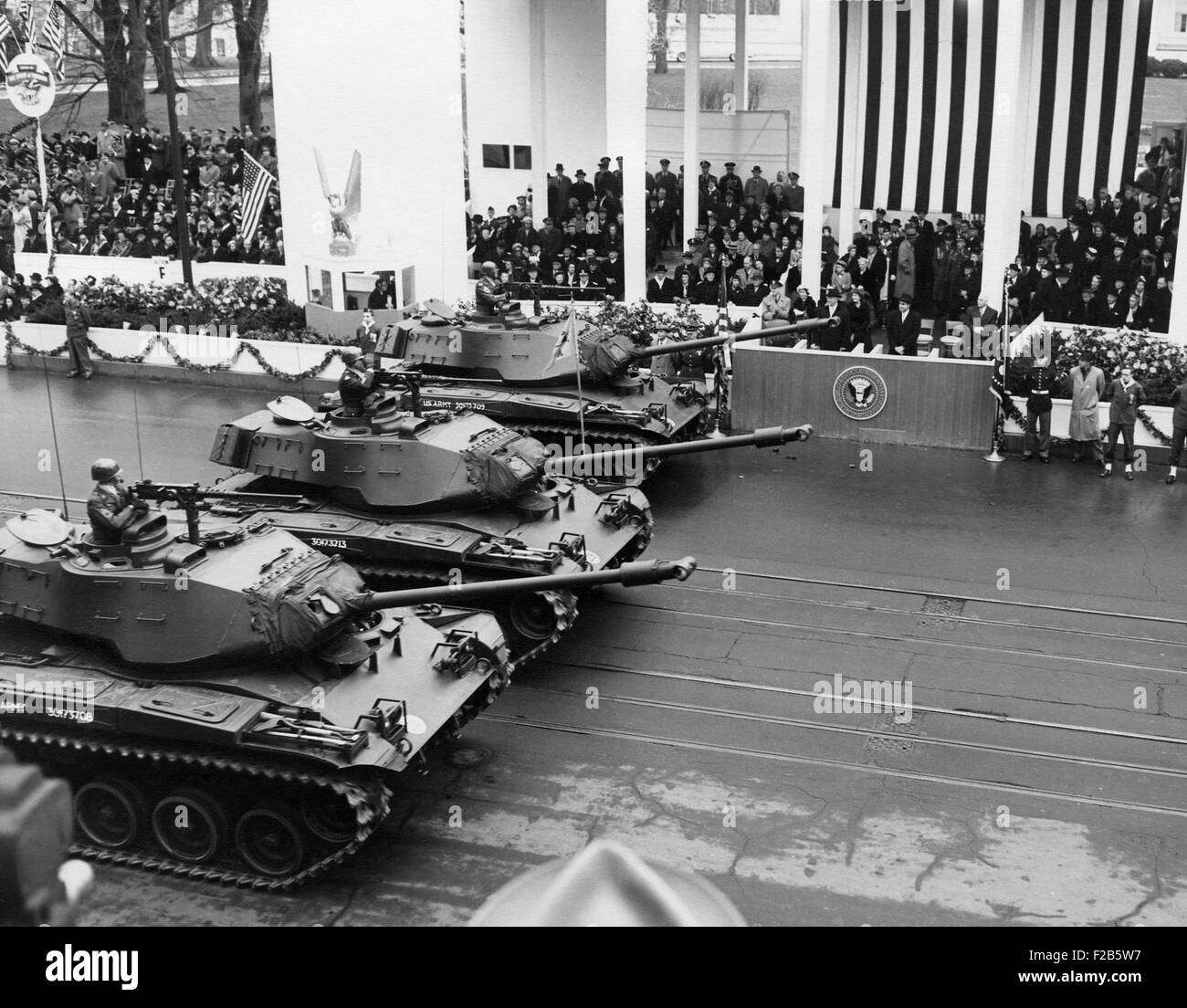 U.S. Army tanks pass Eisenhower's reviewing stand during the Inaugural parade. Jan 21, 1957. - (BSLOC20141638) Stock Photo