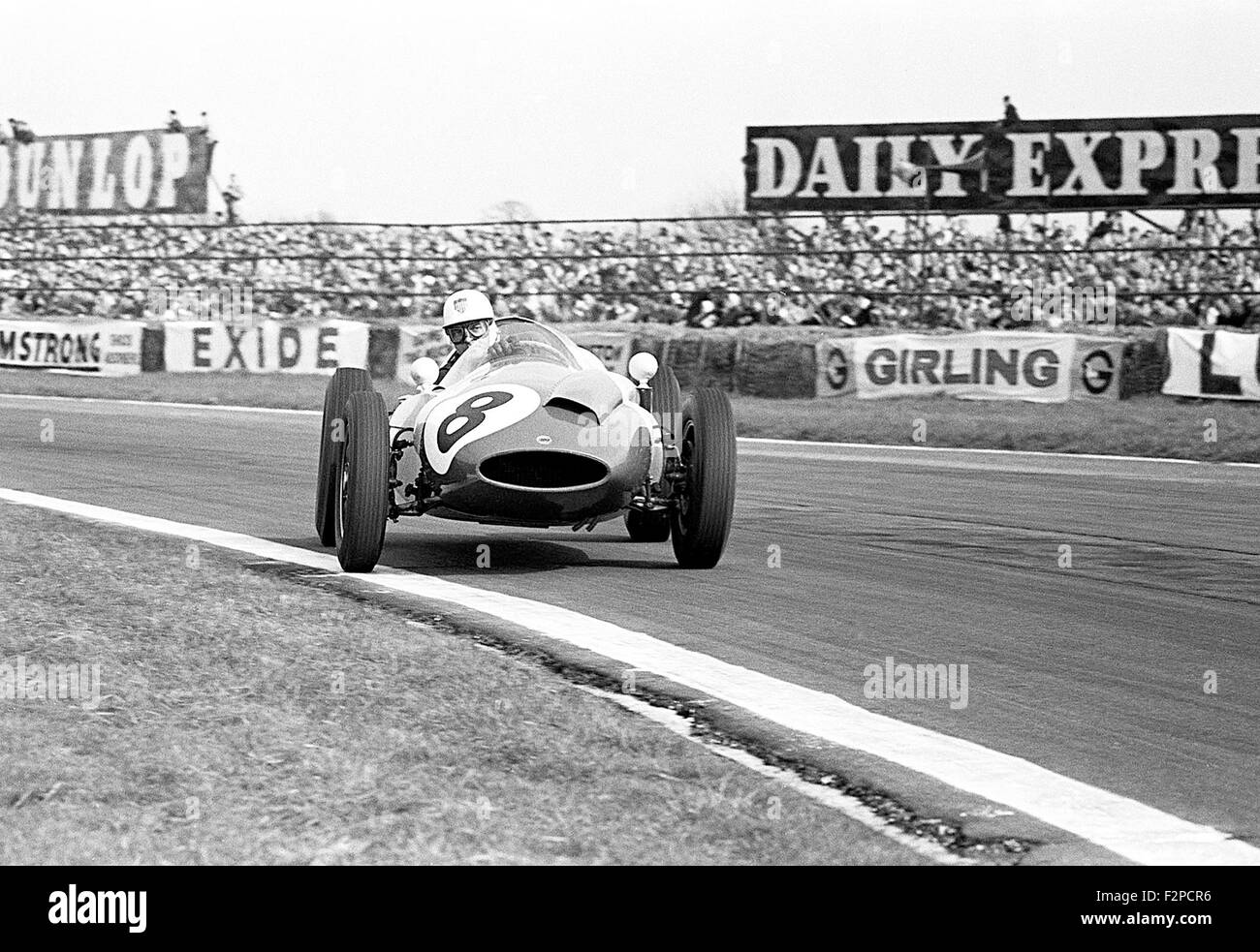 Harry Schell in a Yeoman Credit Cooper T51 racing at Easter at Goodwood 1960 Stock Photo