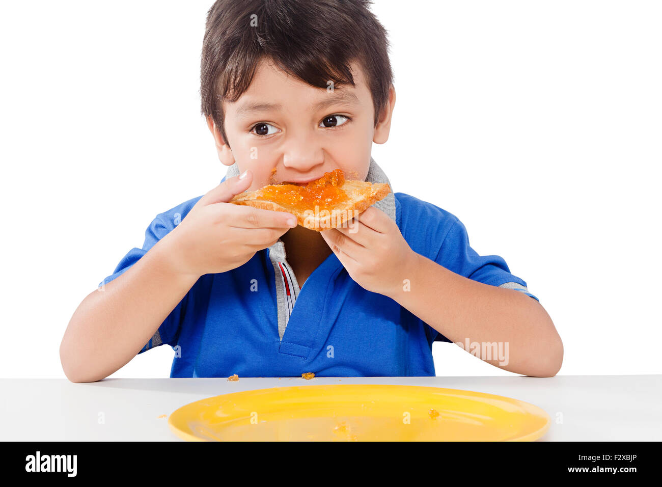 1 indian kid boy Breakfast eating Bread Stock Photo ...