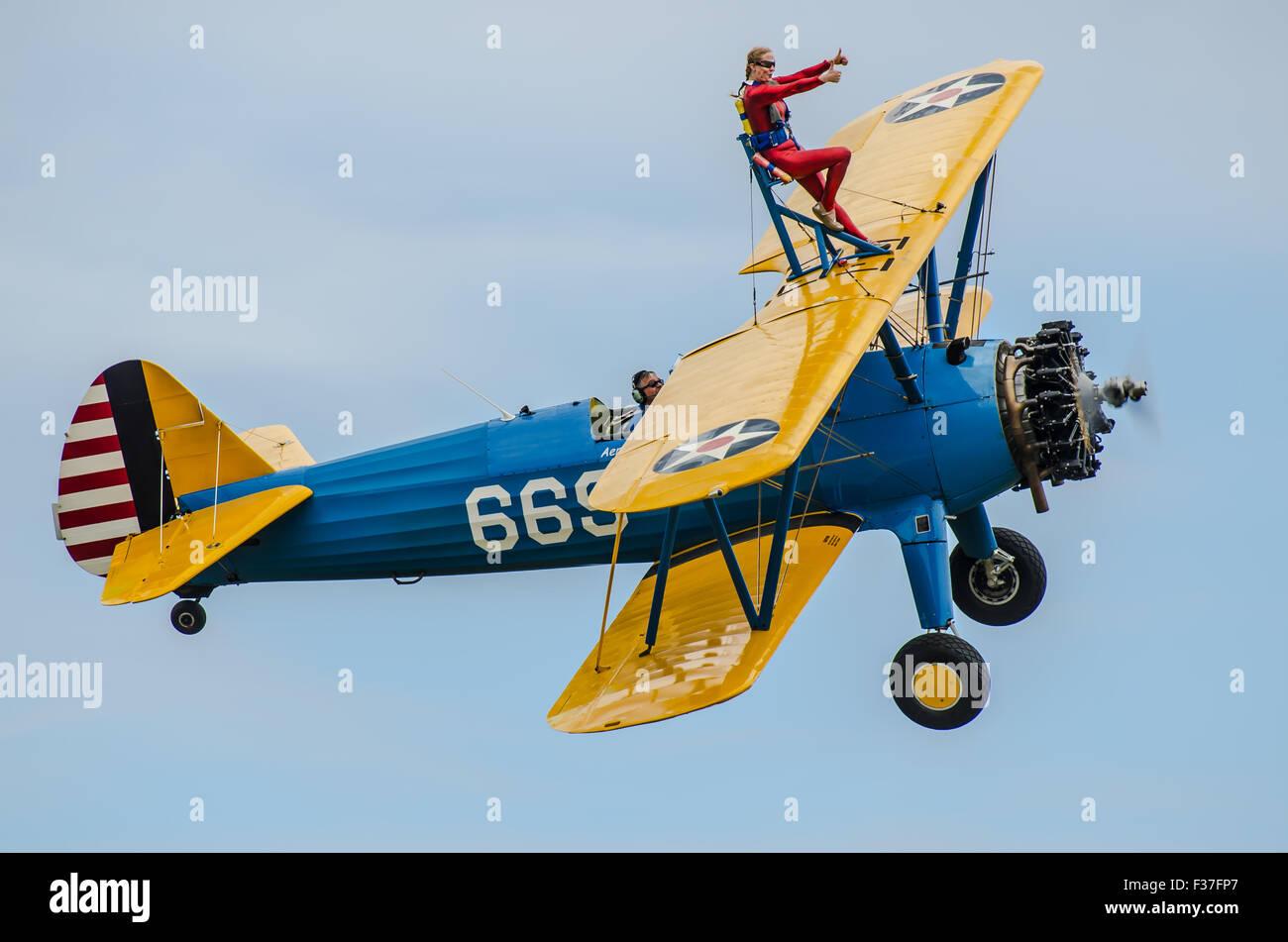emma-stewart-rigby-wing-walking-atop-a-boeing-stearman-biplane-plane-F37FP7.jpg