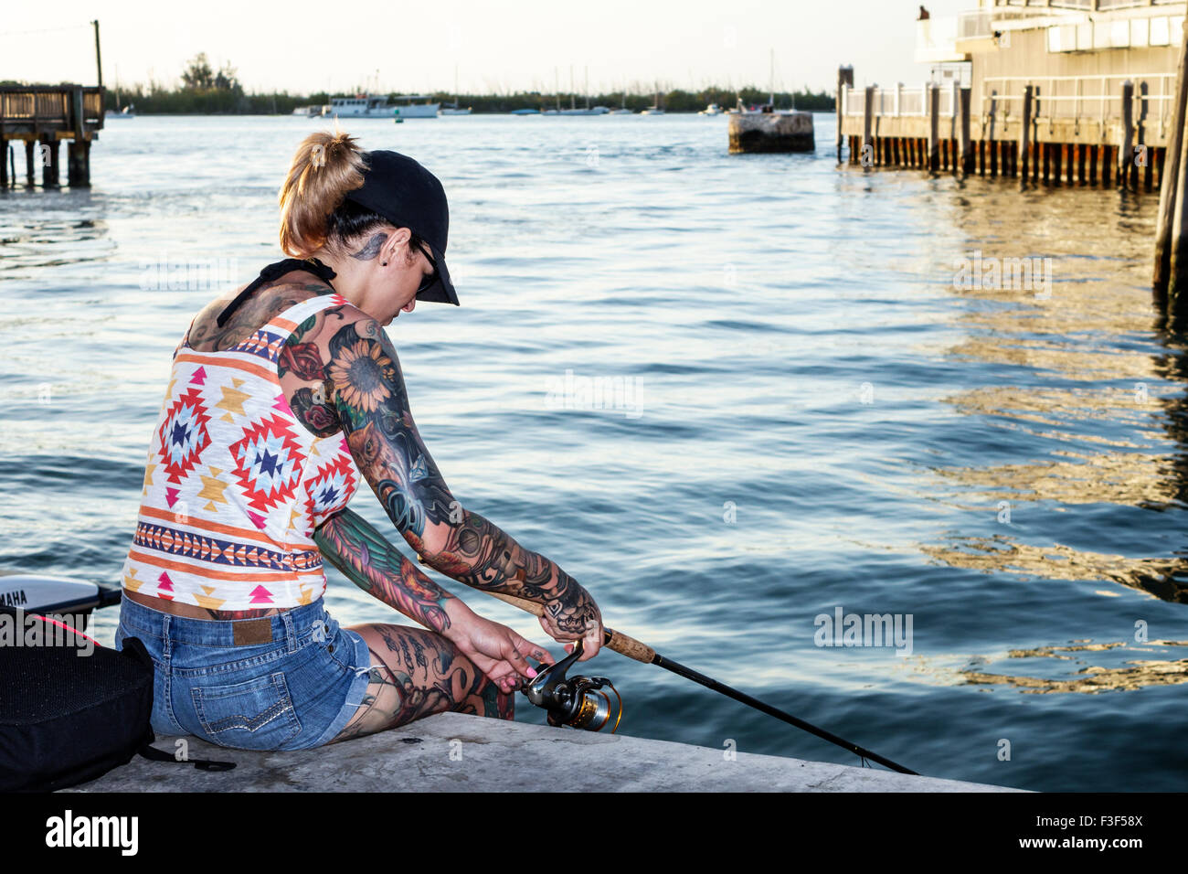 Key west florida keys sunset pier woman tattoos fishing for Key west fishing pier