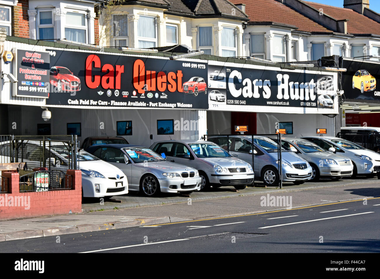 second hand used cars for sale along ground floor house. Black Bedroom Furniture Sets. Home Design Ideas