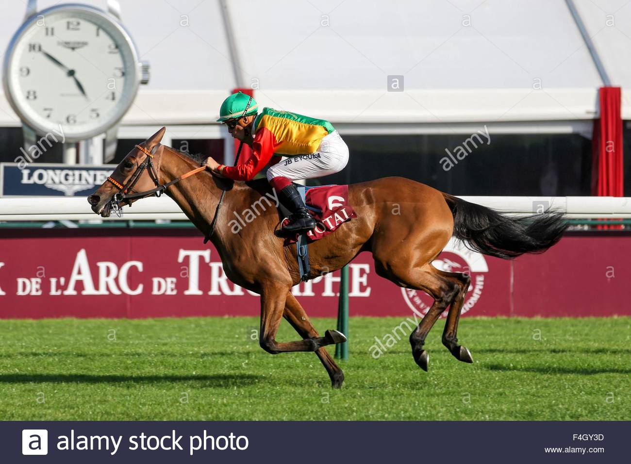 Paris, France. October 3rd, 2015. FRANCE, Paris: A jockey gets on a horse during 94th Prix de l'Arc de Triomphe Stock Photo