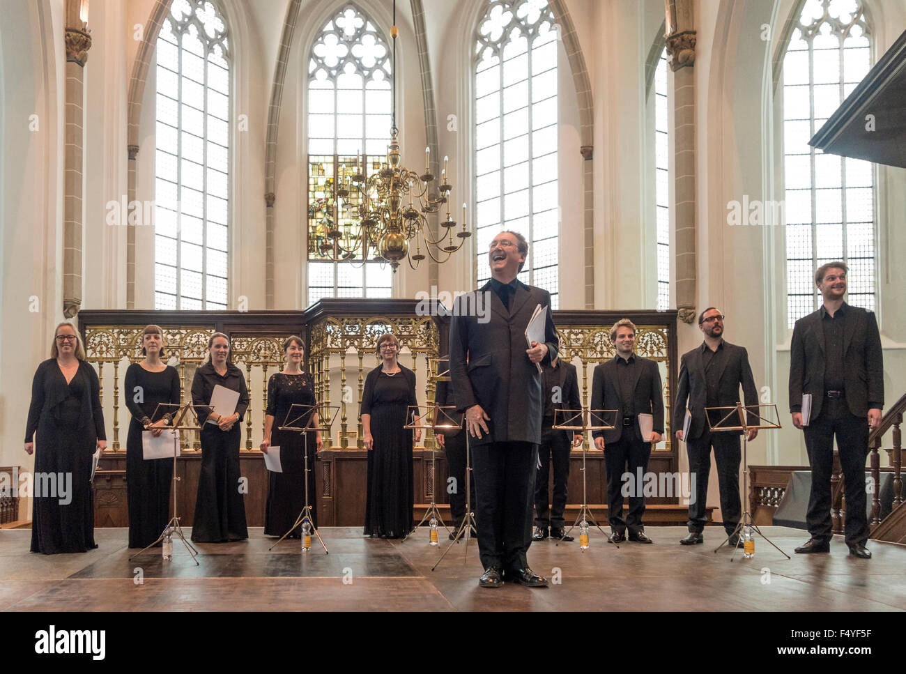 http://c7.alamy.com/comp/F4YF5F/the-tallis-scholars-with-peter-phillips-on-stage-in-a-church-F4YF5F.jpg