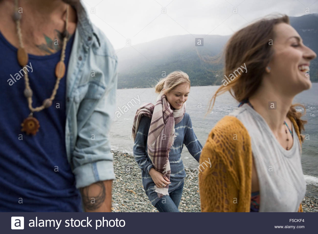 Young friends walking at lakeside Stock Foto