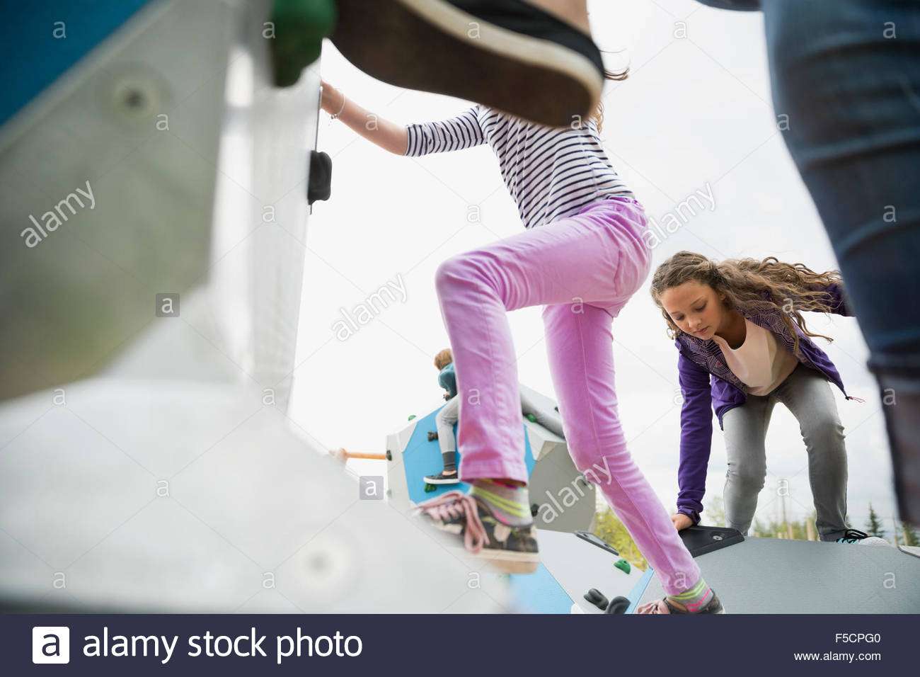 Kids climbing geometric shapes at playground Stock Photo