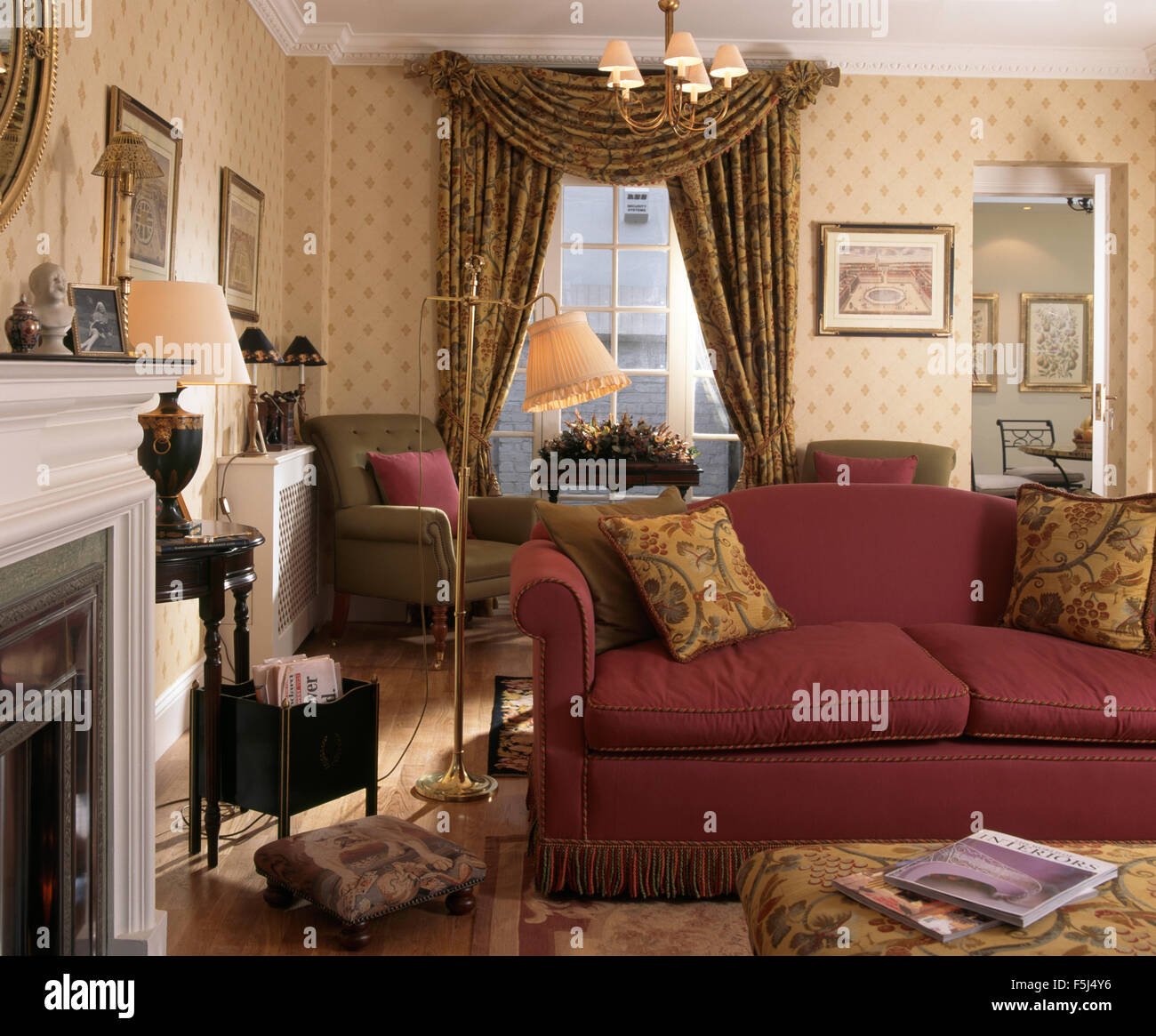 Red sofa in an old fashioned nineties living room with for Red living room wallpaper