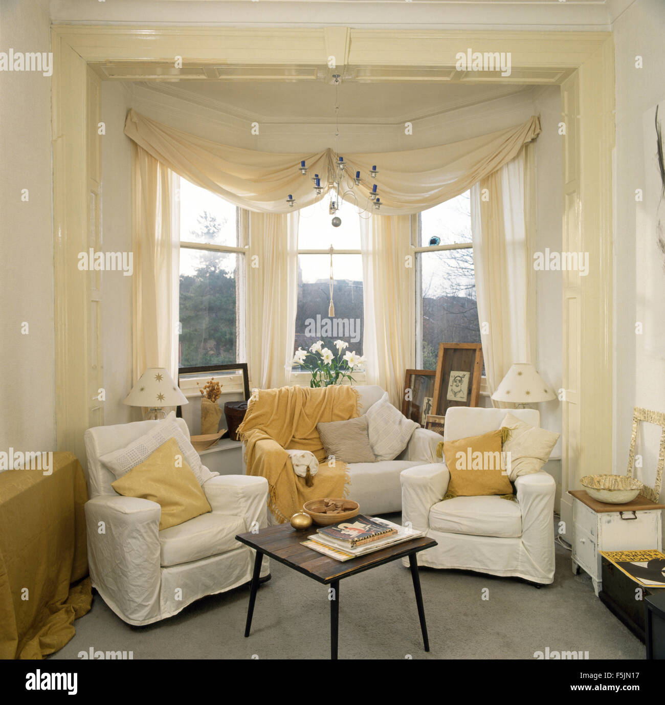 White Swagged Voile Curtains On Bay Window In A Nineties