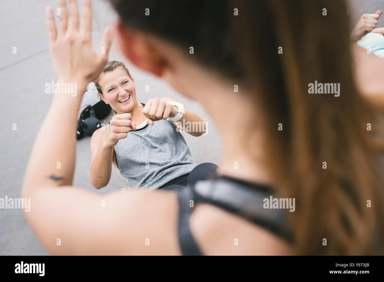 Women having an outdoor boot camp workout Stock Photo