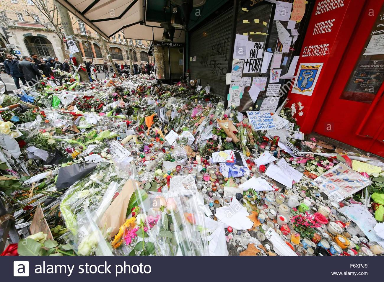 Paris, France. novembre 21st, 2015. FRANCE, Paris: Flowers and candles are shown near La belle Equipe cafe on November Stock Photo