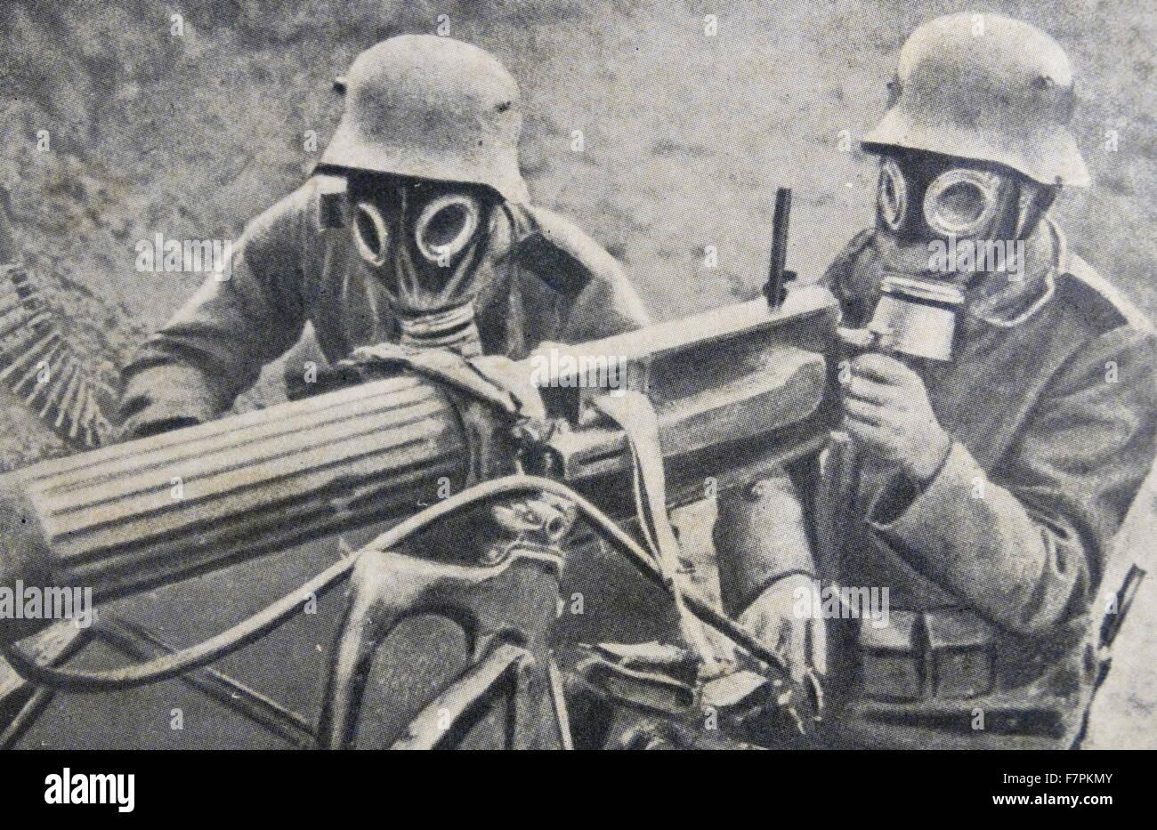 World war one: German soldiers in gas masks use a machine ...
