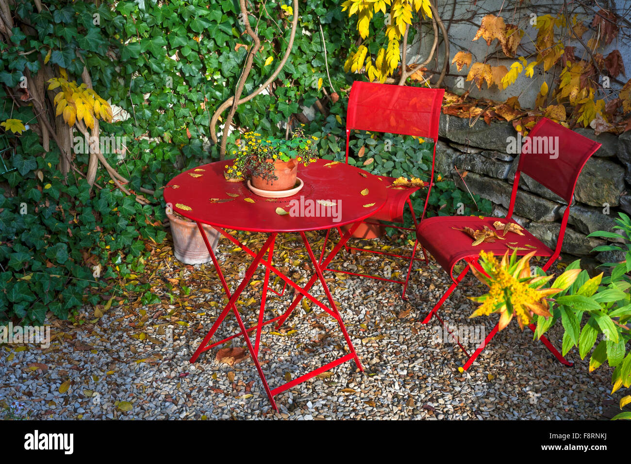 Patio With Red Garden Furniture In Autumn Middle