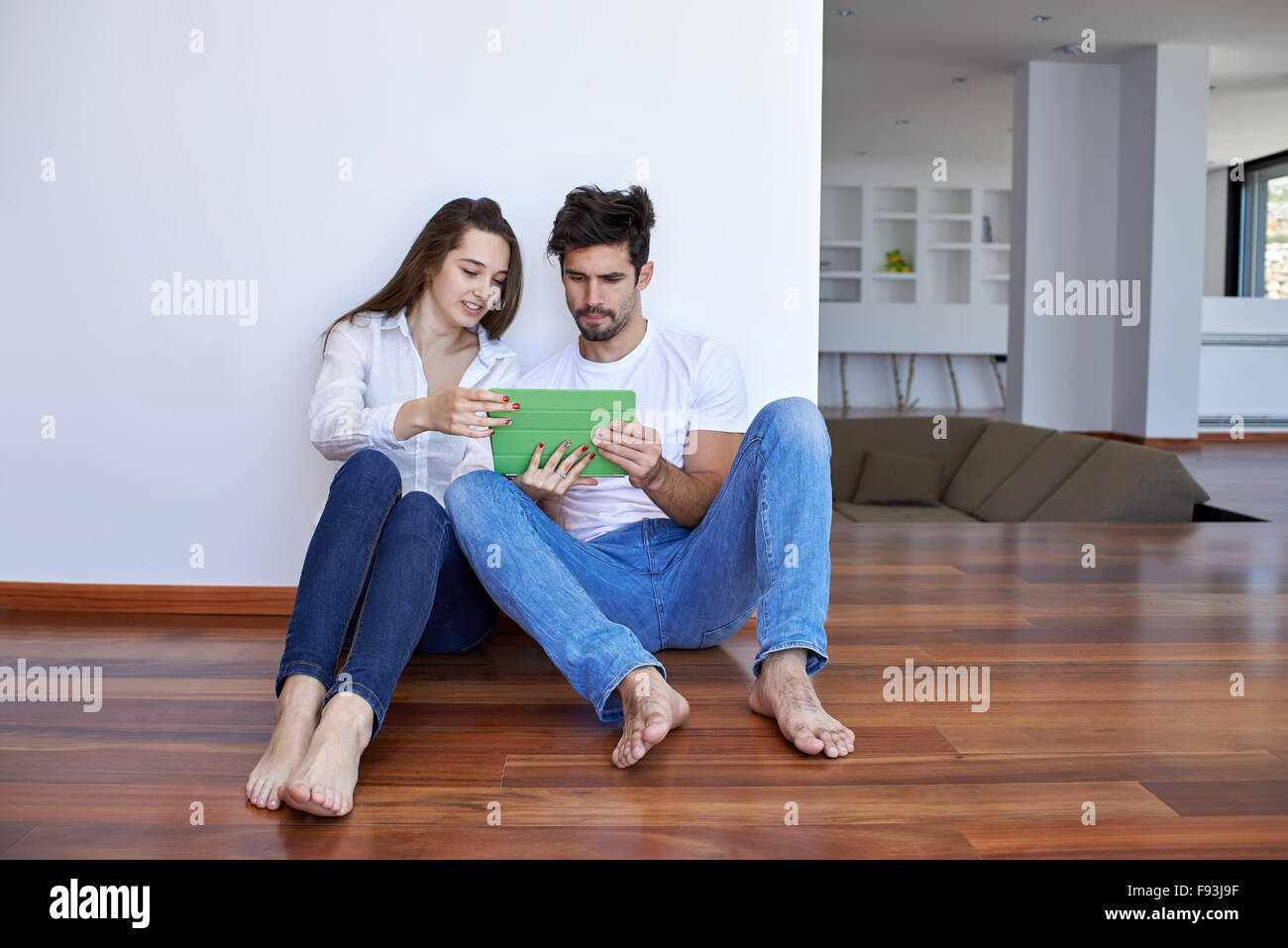 Romantic relaxed young couple at modern home using tablet computer stock photo royalty free - Young couple modern homes ...