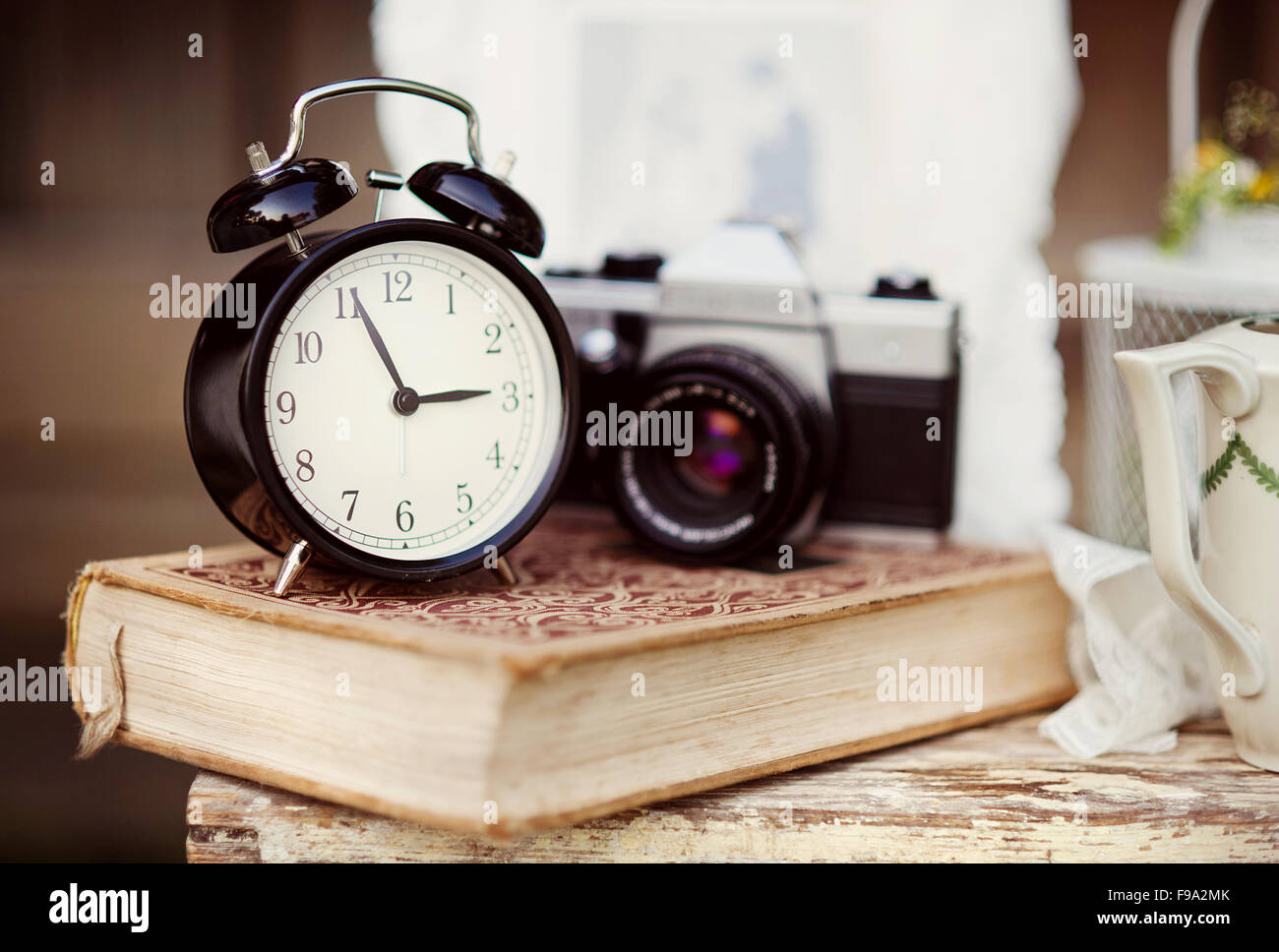 group of objects on vintage wooden table old alarm clock retro stock photo royalty free image. Black Bedroom Furniture Sets. Home Design Ideas