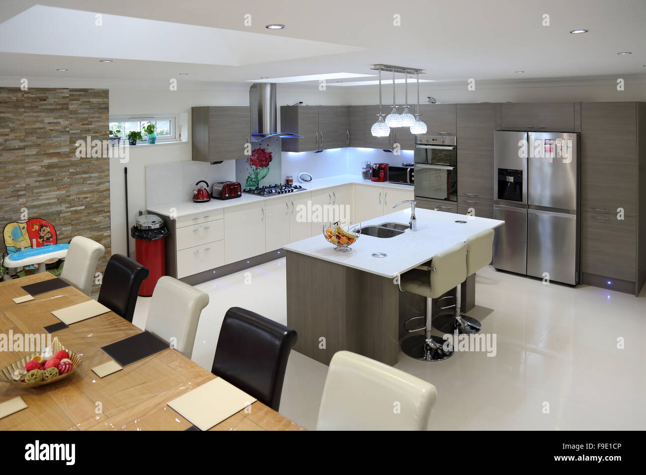 Kitchen dining room in a newly refurbished house showing Living room bar with fridge