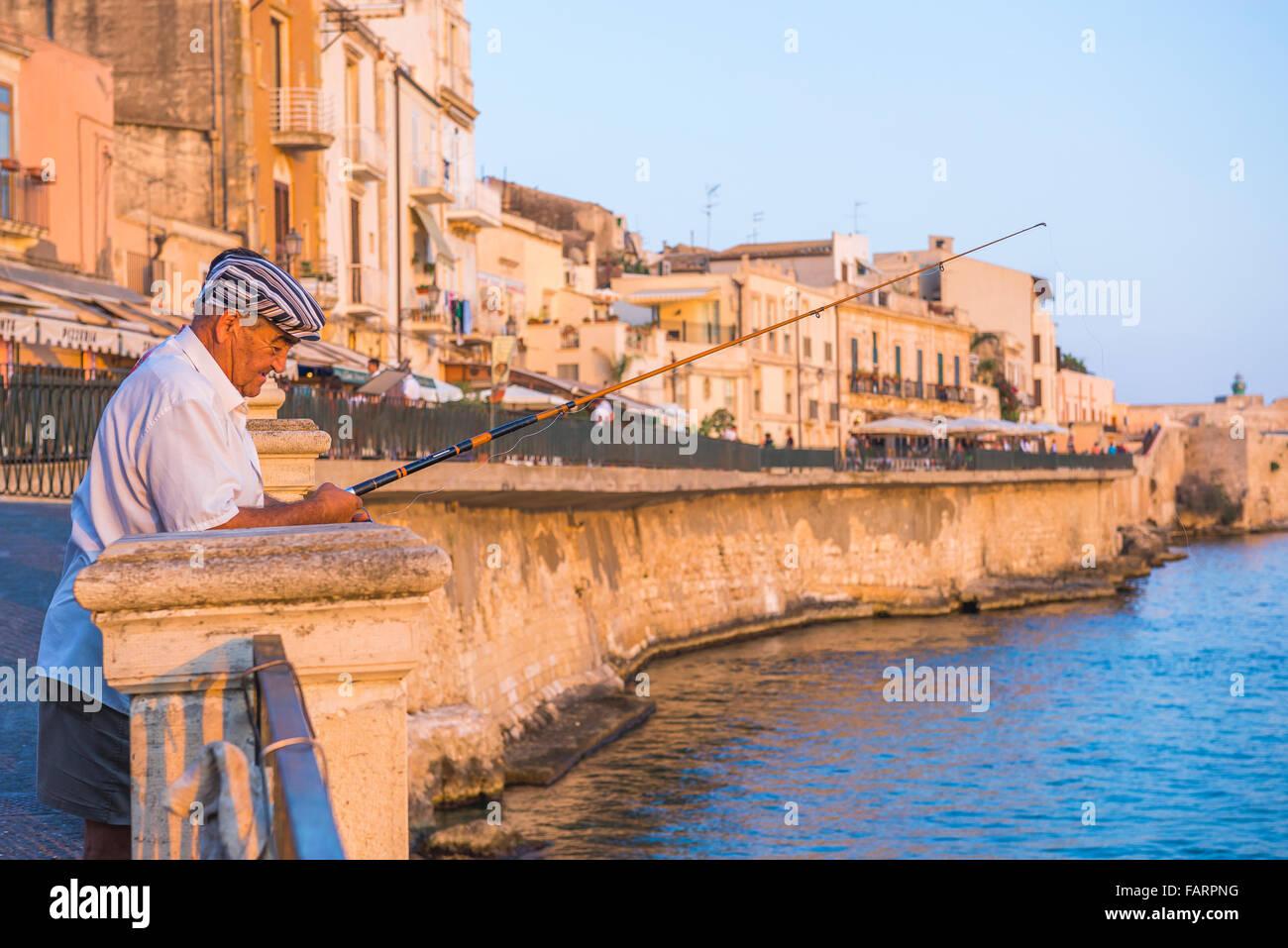 man-fishing-sicily-at-sunset-a-man-fishe