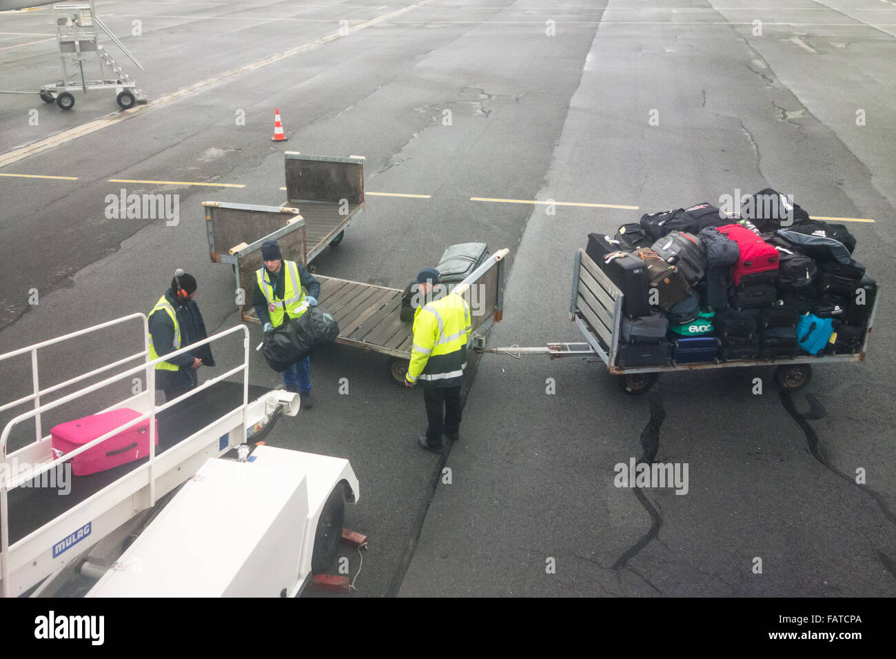 baggage-handlers-loading-suitcases-and-b