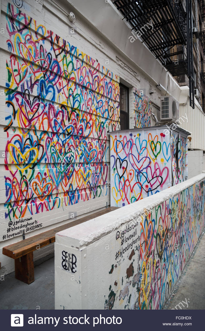 Iconic bleeding hearts love wall graffiti by artist for Mural on broome street