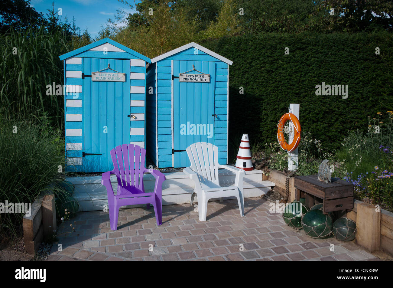 Seaside display of garden sheds painted as beach huts for Beach hut ideas
