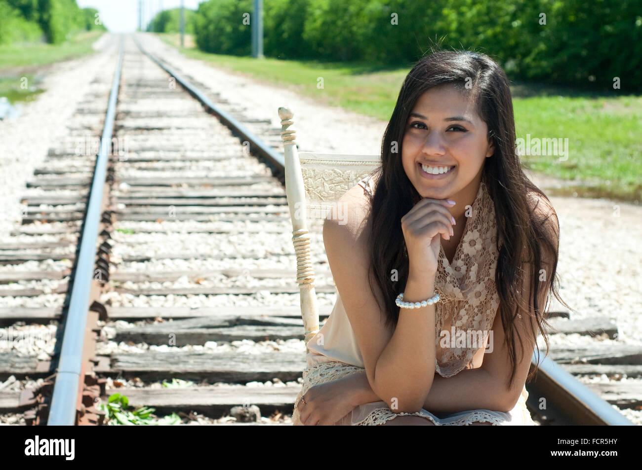 Teen girl on railroad tracks