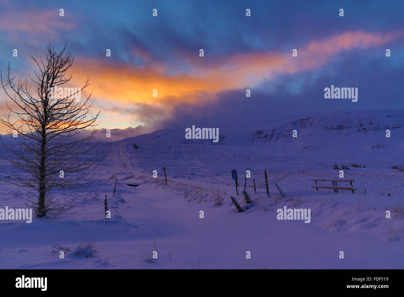 Evening sun catches the clouds after a storm over the snow-covered interior of Iceland Stock Photo