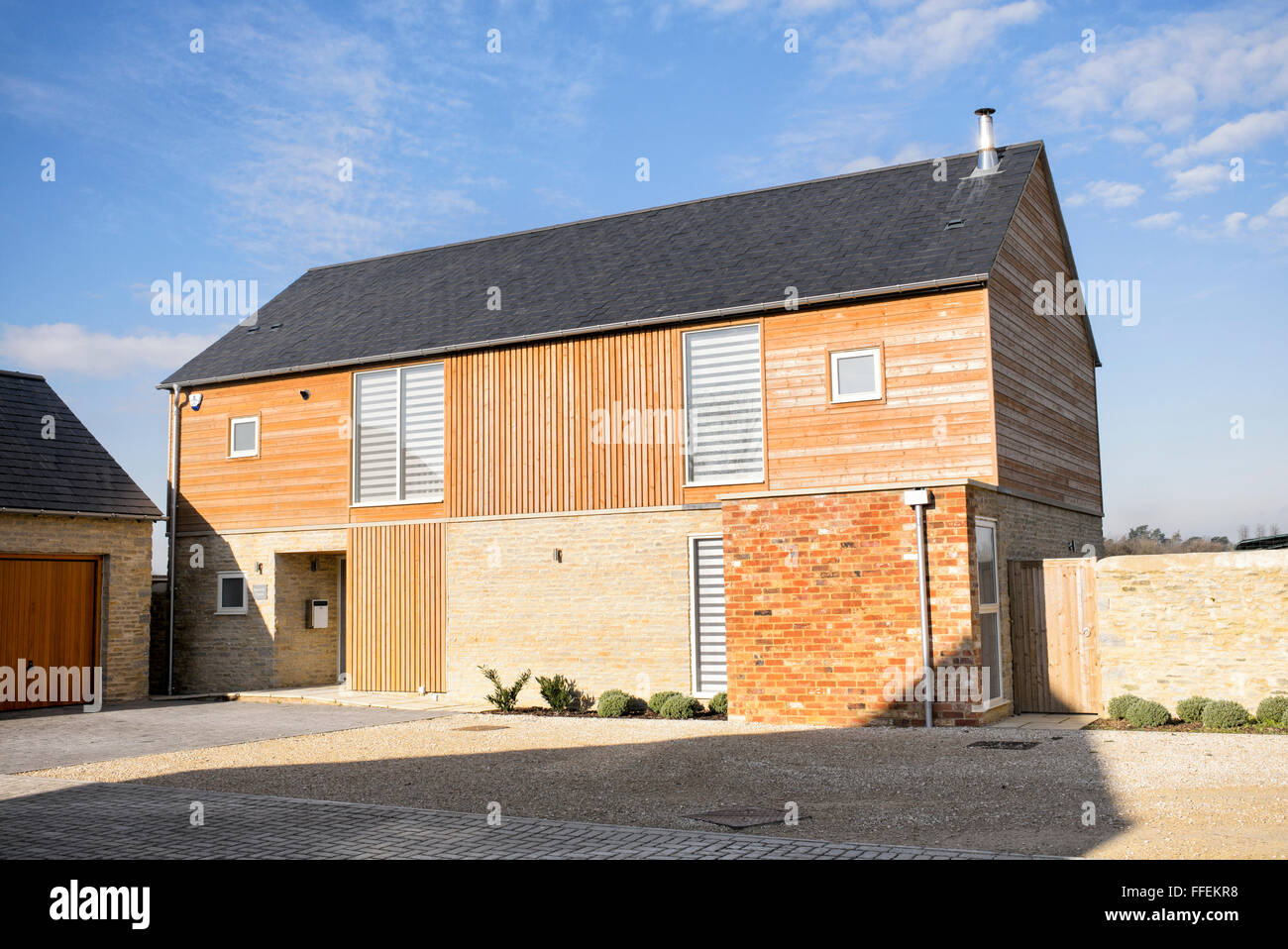 Modern new build wood clad barn style housing bicester for New build barn style house